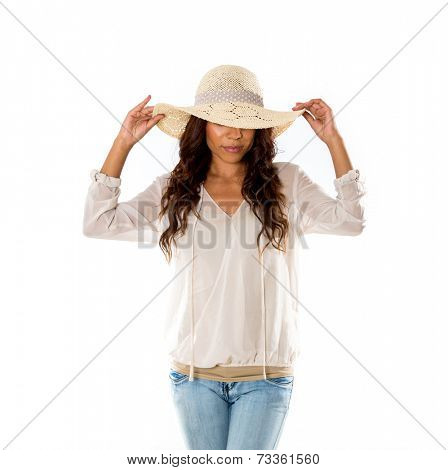 Exotic young woman wearing a sun hat on a white background