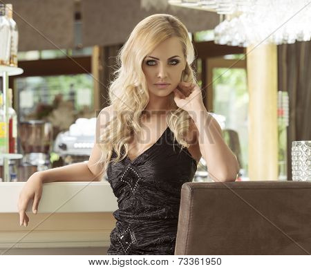 Girl In Black Sitting At Cafe