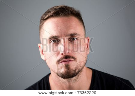 Man With Facial Hair And Serious Look