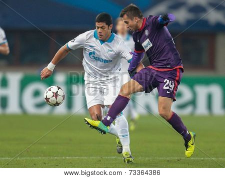 VIENNA, AUSTRIA - DEZEMBER 11 Hulk (#7 Zenit) and Markus Suttner (#29 Austria) fight for the ball at a UEFA Champions League game on Dezember 11, 2013 in Vienna, Austria.
