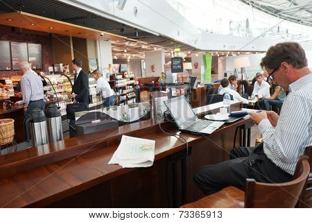 DUSSELDORF- SEP 16: Starbucks cafe interior in airport on September 16, 2014 in Dusseldorf, Germany. International airport of Dusseldorf located approximately 7 kilometres north of downtown Dusseldorf