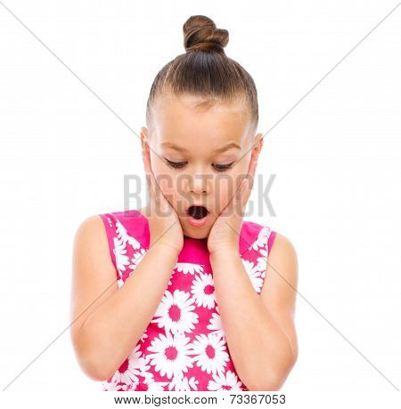 Cute Girl Is Holding Her Face In Astonishment