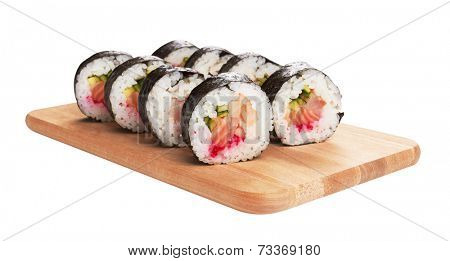 Sushi rolls served on a wooden plate, isolated on white