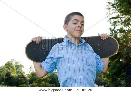 Teen With His Skateboard