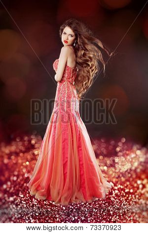 Beautiful Glam With Long Hair Posing In Red Dress Over Bokeh Bright Background.