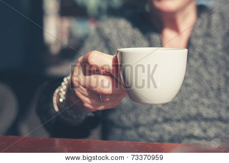 Elderly Woman Drinking Coffee Outside