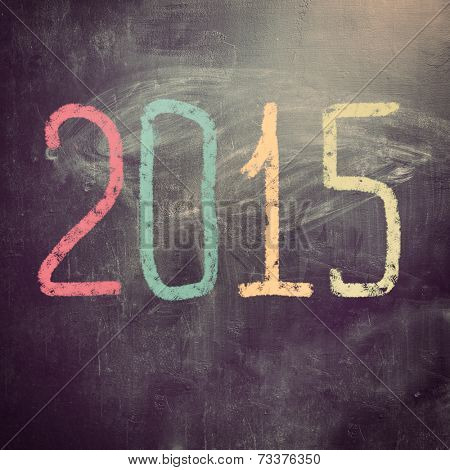 new year 2015 written on chalk board for christmas