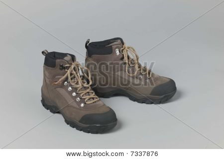pair of new work boots on gray background