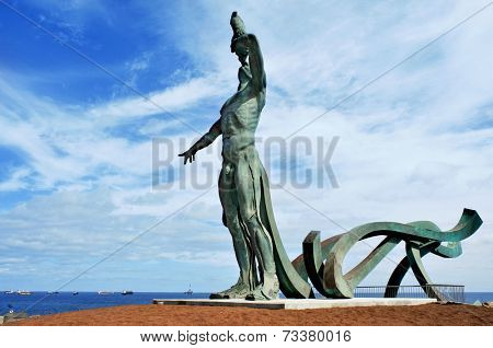 LAS PALMAS DE GRAN CANARIA, SPAIN - OCTOBER 13, 2013: The sculpture Exordio del Triton in Punta del Palo in Las Palmas de Gran Canaria, Spain. Designed by Manolo Gonzalez, is a landmark in the city