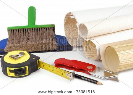 wallpaper and tools isolated on white