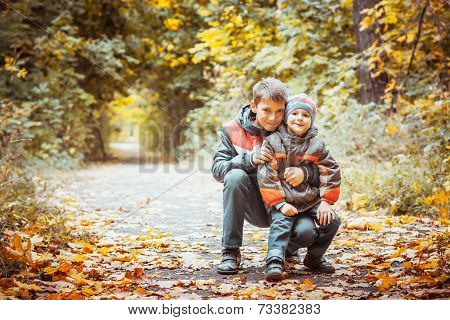 two brothers in autumn park