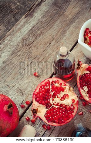 Pomegranate And Bottles Of Essence Or Tincture, Top View