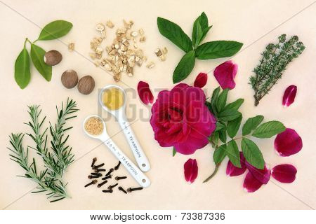 Love potion ingredients with measuring spoons over mottled cream background.