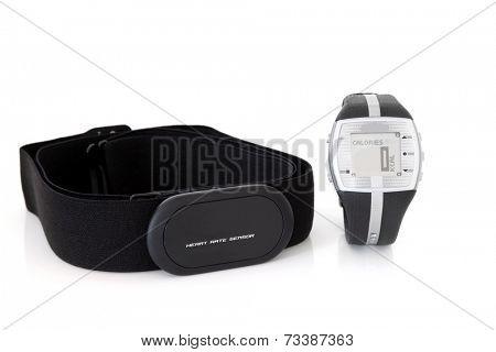 Heart rate monitor sensor and calorie counter watch over white background.