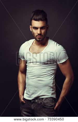 Handsome Man Posing In Studio On Dark Background