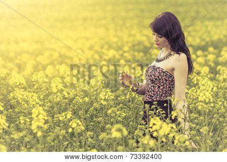 Beautiful Woman In Meadow Of Yellow Flowers
