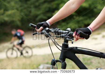Woman Hands On Bicycle Handle Bars