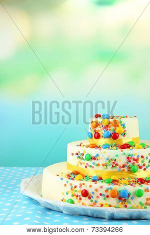 Beautiful tasty birthday cake on light background