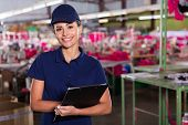 picture of production  - cheerful young clothing factory supervisor standing in production area - JPG