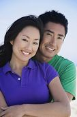 picture of adoration  - Asian couple hugging - JPG