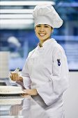 stock photo of pastry chef  - Asian female pastry chef holding piping bag - JPG