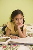 image of pacific islander ethnicity  - Pacific Islander girl reading book - JPG