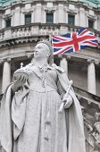 stock photo of sceptre  - Queen Victoria Statue with Union Flag Behind - JPG