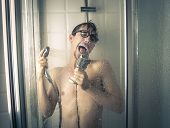 image of douching  - A singer under the shower  - JPG