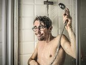 foto of douching  - Funny man under the shower  - JPG