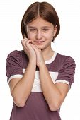 stock photo of shy girl  - A shy preteen girl on the white background - JPG