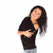 stock photo of straight jacket  - Glamorous young woman in black jacket and jeance on white background studio - JPG