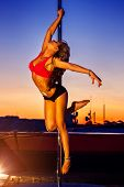 picture of pole dance  - Young sexy pole dance woman on urban background - JPG