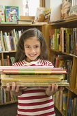 stock photo of pacific islander ethnicity  - Pacific Islander girl holding library books - JPG