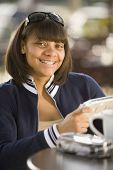 stock photo of braces  - African teenaged girl with orthodontic braces - JPG