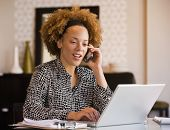 pic of telecommuting  - African businesswoman talking on cell phone - JPG