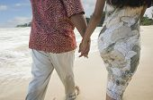 foto of pacific islander ethnicity  - Pacific Islander couple walking on beach - JPG