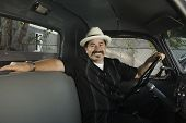 picture of 55-60 years old  - Hispanic man sitting in truck - JPG