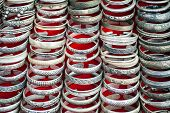 stock photo of bangles  - Lot of cheap souvenir bangles at asian market place - JPG