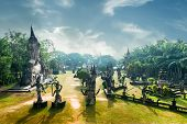 stock photo of religious  - Amazing panorama view of mythology and religious statues at Wat Xieng Khuan Buddha park. Vientiane Laos