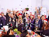stock photo of party hats  - Happy group people in santa hat at Xmas business  party - JPG
