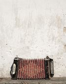 picture of accordion  - wall and accordion on the bench background - JPG