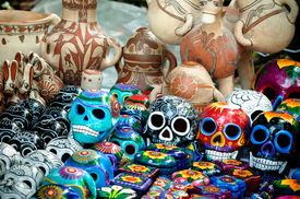 image of day dead skull  - Traditional mexican day of the dead souvenir ceramic skulls at market stall - JPG