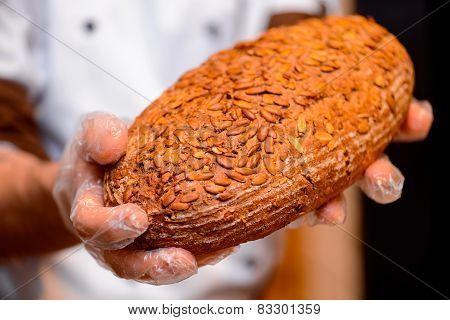 Bread in the hands of baker