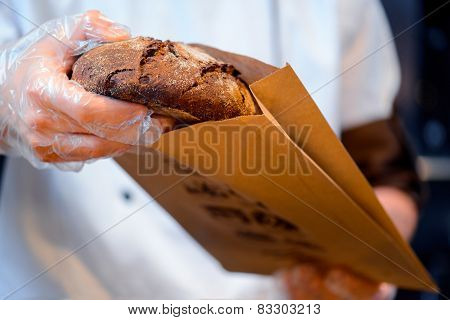 Bread in the hands of baker