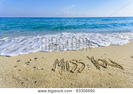 MISS YOU written in the sand, ocean landscape
