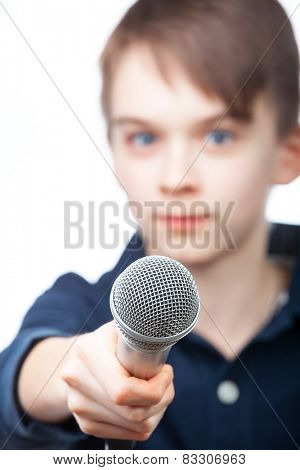 Boy holding microphone, fucus on mic