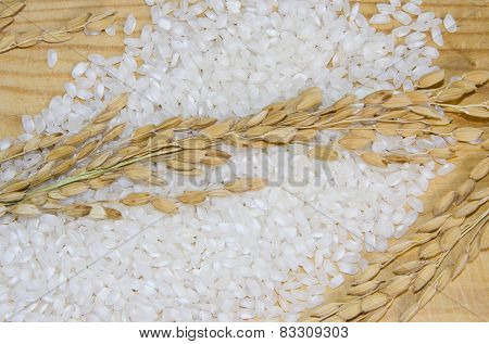 White rice on wooden table