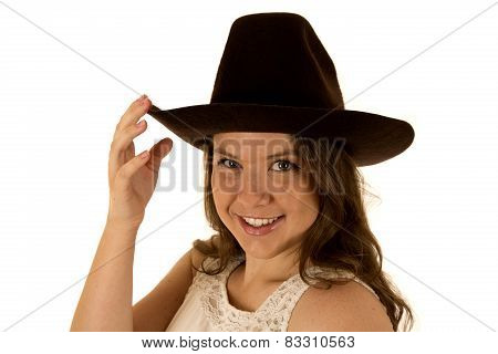 Cowgirl Wearing White Dress And Cowboy Hat Smiling