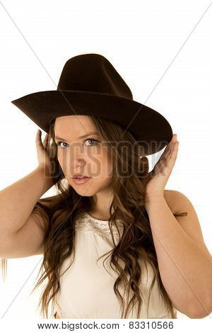 Cowgirl Wearing A White Dress Adjusting Her Cowboy Hat