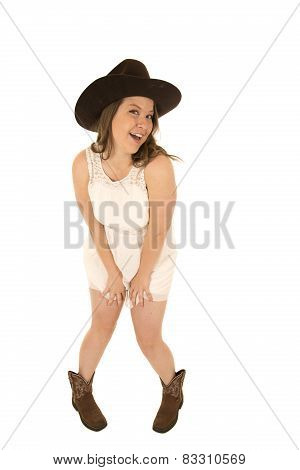 Model Wearing A White Dress, A Cowboy Hat And Boots